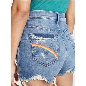 Mother learning to hula rainbow pocket shorts.